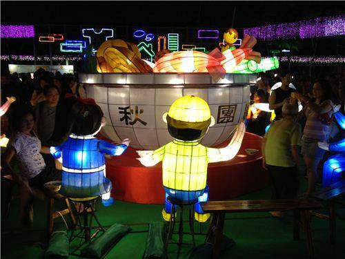 Lots of lantern people gathered around a Chinese Hot Pot
