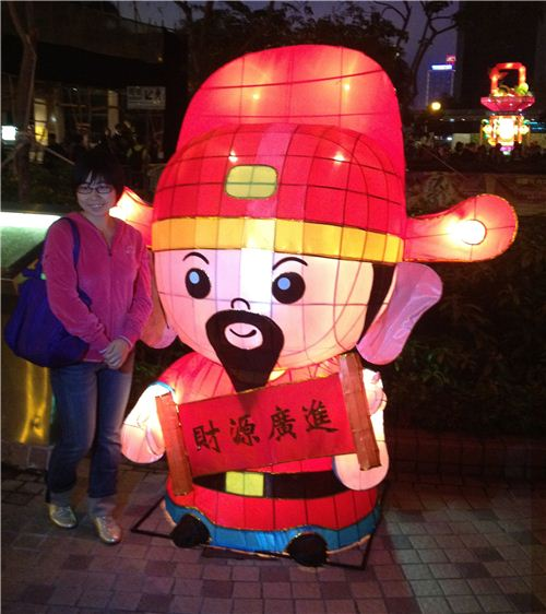 People want a picture with the cute lantern guy wishing good luck in Chinese