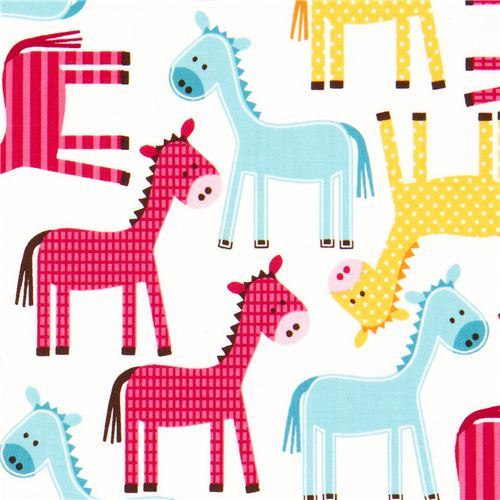 white fabric with dotted horses by Robert Kaufman USA