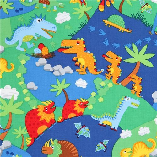 colorful dinosaur land fabric by Timeless Treasures