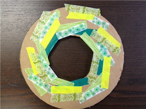 Start sticking pieces of Washi Tape on the cardboard