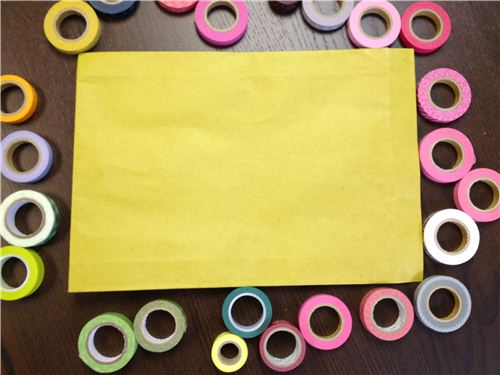 You need a big envelope and colorful Masking tapes