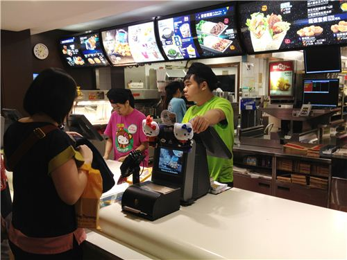 The McDonalds staff wear colourful Hello Kitty T-Shirts