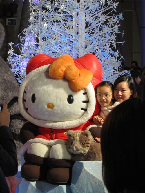 adorable Hello Kitty in warm winter clothes