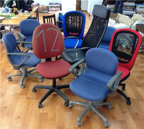 Twelve different office chairs, although not all of them are used constantly