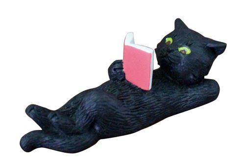 black cat lying down reading red book figurine from Japan