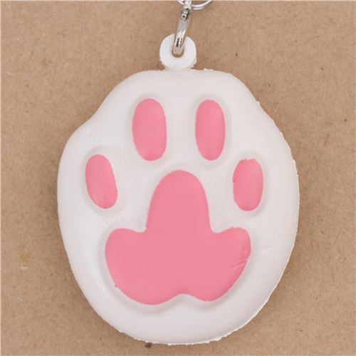 kawaii white animal squishy charm with pink cat paw