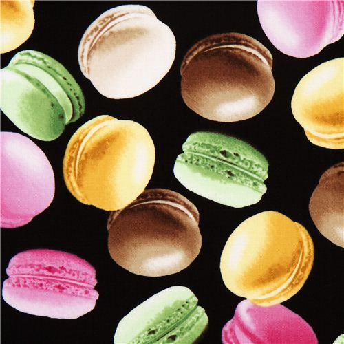 black fabric with french macaroons