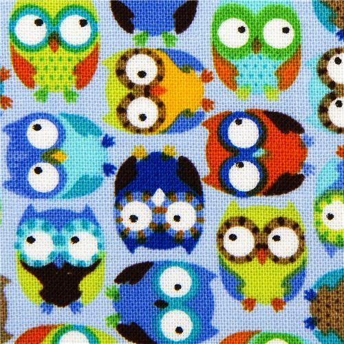 light blue designer fabric with small colourful owls