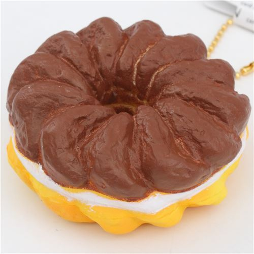 cute dark brown orange-yellow French cruller white filling squishy charm kawaii
