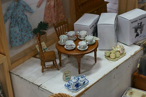 'Honey I shrunk the china.' Incredibly detailed tableware.
