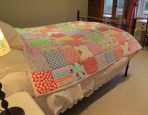 Stay warm with a delightful patchwork quilt. Courtesy of Rosie Buttons.