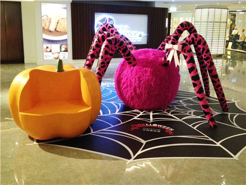 This smaller Pinkloween spider can be found in Mira Mall