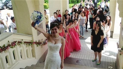Of course the bride threw the bridal bouquet
