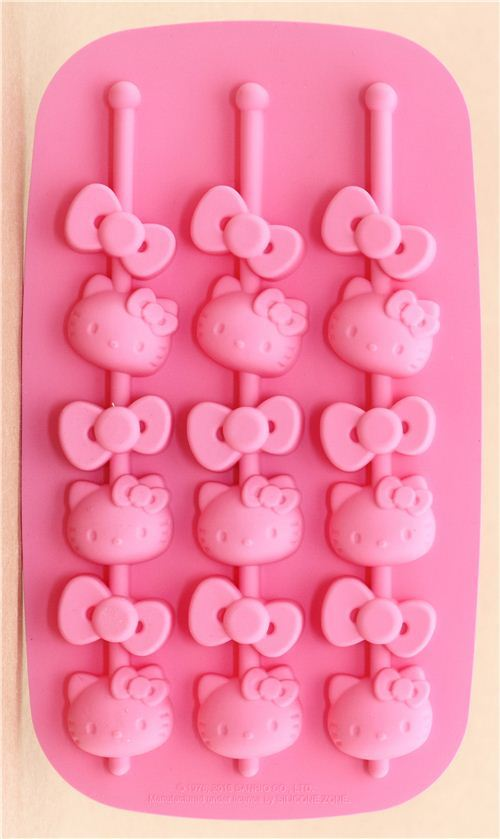 pink Hello Kitty silicone ice cube and chocolate mold with ice wand