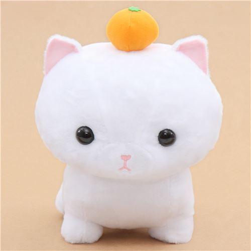 big white cat with an orange Noseteru Munchkin plush toy Japan