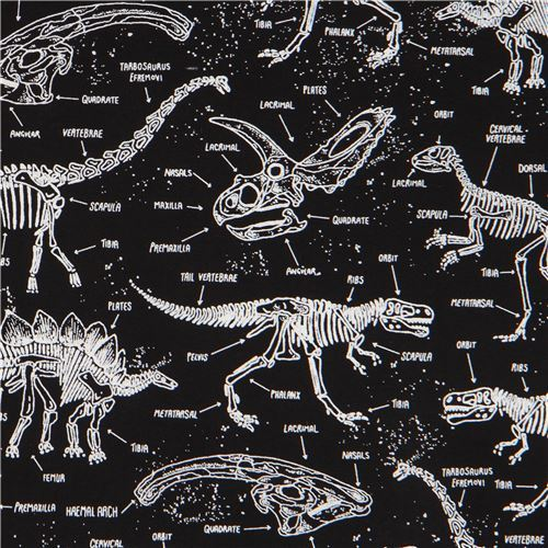 black fabric with glow in the dark dinosaur skeleton by Timeless Treasures