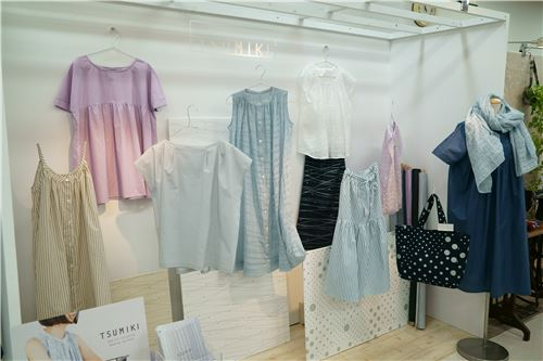 Tsumiki fabrics as clothing items on display